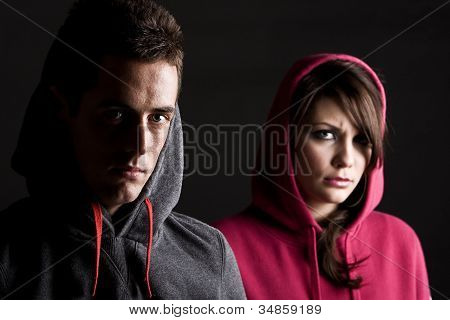 Teenagers Against Dark Background