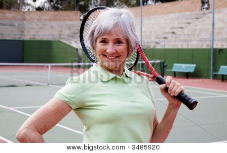 Senior Playing Tennis