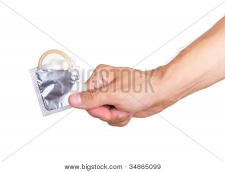 Hand With Condom Isolated On White