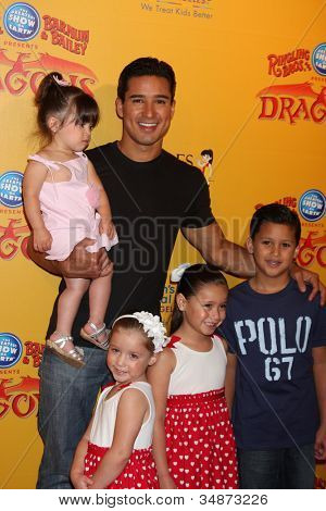 LOS ANGELES - JUL 12: Mario Lopez, daughter and relatives arrive at 'Dragons' presented by Ringling Bros. & Barnum & Bailey Circus at Staples Center on July 12, 2012 in Los Angeles, CA