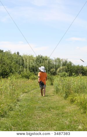 Back Of Young Boy On Walking Trail