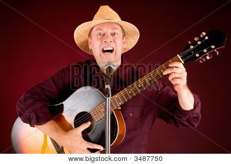 Singing And Playing Acoustic Guitar