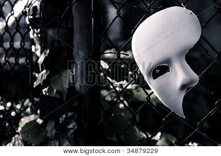 Masquerade - Phantom of the Opera Mask on Rusty Chain Link Fence