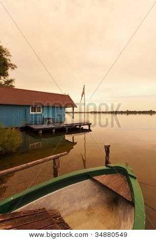 Blue boathouse and boats at Schaalsee lake, Mecklenburg-Vorpommern, Germany