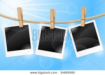 Photos hanging on a clothesline