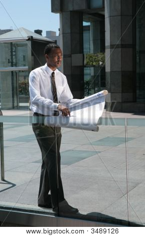 Serious Architect Looking At Blueprints