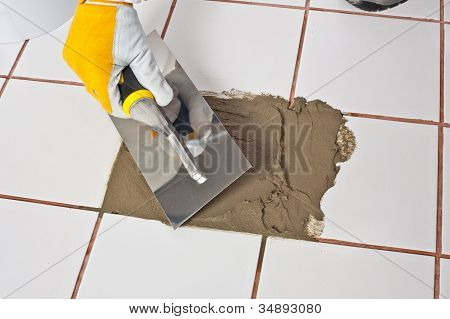 Repairing Old Tiles With Tile Adhesive