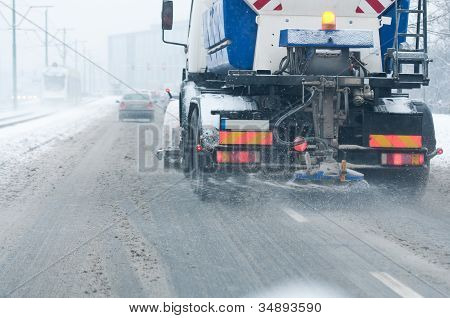 Snowblower In The Street During The Winter