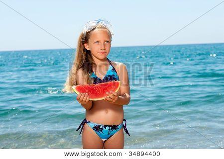 Cute Girl Eating Watermelon On Beach.