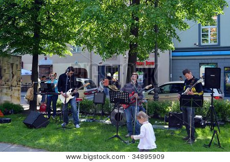 Musicians Play Guitar And Sing In City Center