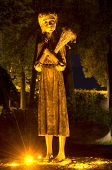 Monument Of A Girl To The Holodomor Victims In Night