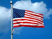 picture of waving american flag  - American Flag against blue sky - JPG