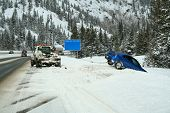 picture of wench  - Car stuck in a snow bank on the side of the highway - JPG