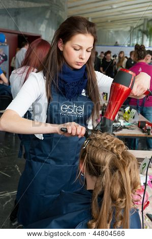 MOSCOW - APRIL 19: Unidentified orphan children, age 13-16, compete in hairdressing at the contest Young Master on April 19, 2013 in Moscow. Orphans were trained by charitable foundation Color of Life