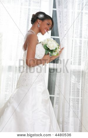 Beautiful Young Bride Standing By The Window