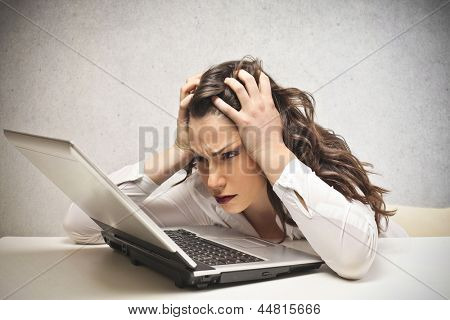 stressed businesswoman looks laptop