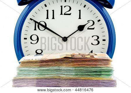 an alarm clock and banknotes, symbolic photo for wage costs, labor costs, working time