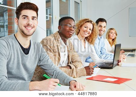 Happy students learning in class in a university