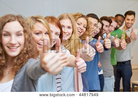Happy students in a row holding their thumbs up