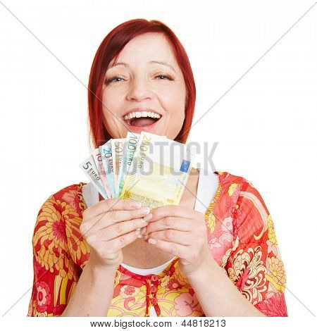 Successful woman with fan of Euro money bills