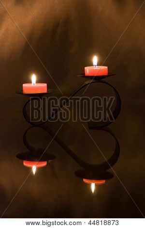 Candles Flare And Candleholder Reflection In Form Of Heart