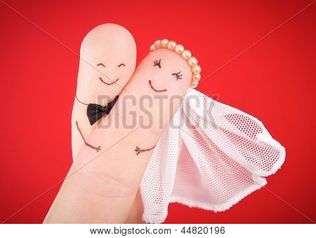 Wedding Concept -  Newlyweds Painted At Fingers Against Red
