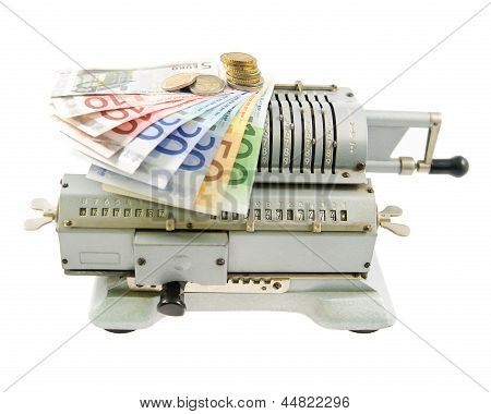 Vintage Mechanical Adding Machine And Money Isolated On White