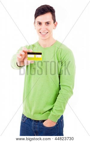 Young casual man with credit card on white background
