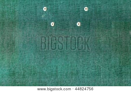 Old green cardboard with buttons