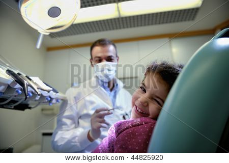 Young Girl Lying On Couch In Dentist Studio Looking At Camera