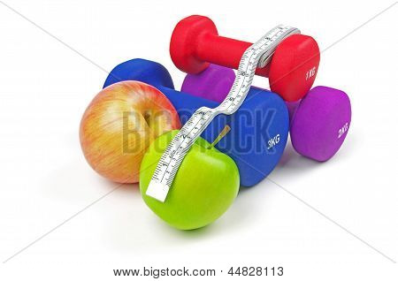 fitness weights apples and measuring tape