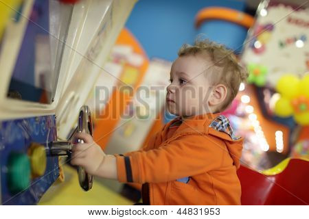 Child Playing With Amusement Machine