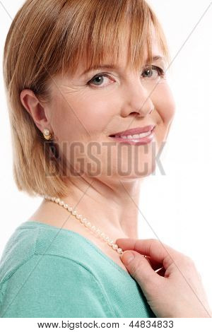 Beautiful middleaged woman with short hair on a white background