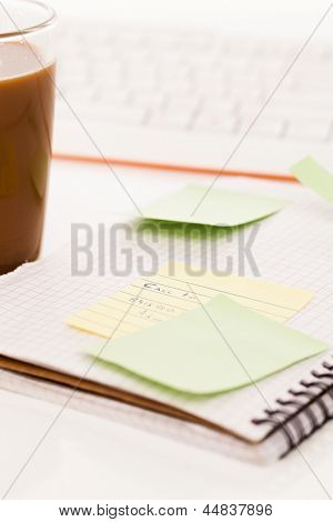 Postit papers attached to a squared notebook