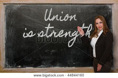 Teacher Showing Union Is Strength On Blackboard