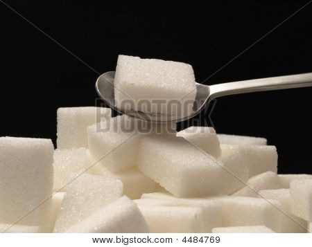 Sugar Cubes And Tea-spoon