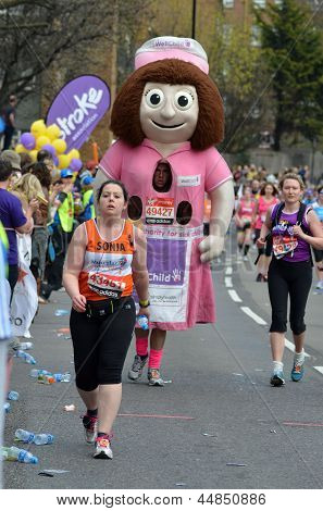 Fun Runners Take Part In The 2013 London Marathon To Raise Money For Charity On The Streets Of Londo