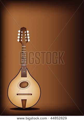 A Beautiful Antique Mandolin on Dark Brown Background