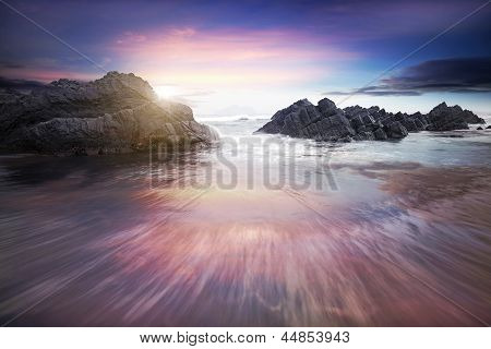 Sea and rock at the sunset. Nature