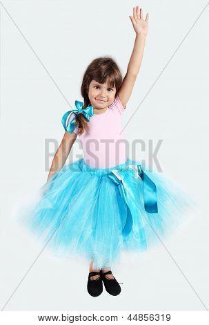 Smiling Girl In Tutu Skirt Hand Up