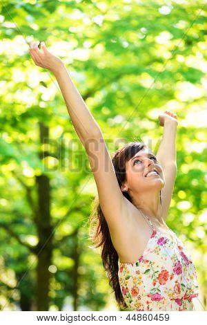 Happy Blissful Woman On Spring Season