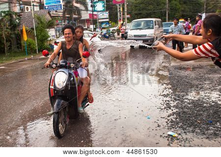 KO CHANG, THAILAND - APR 14: People celebrated Songkran Festival, on 14 Apr 2013 on Ko Chang, Thailand. Songkran is celebrated in Thailand as the traditional New Year by throwing water at each other.