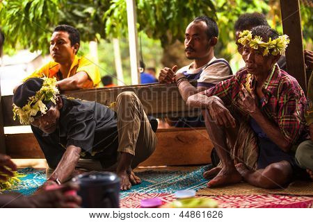 BERDUT, MALAYSIA - APR 8: Unidentified people Orang Asli during the funeral on Apr 8, 2013 in Berdut, Malaysia. More 76% of all Orang Asli live below the poverty line, life expectancy - 53 years old.