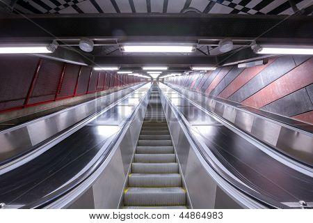modern escalator in futuristic building