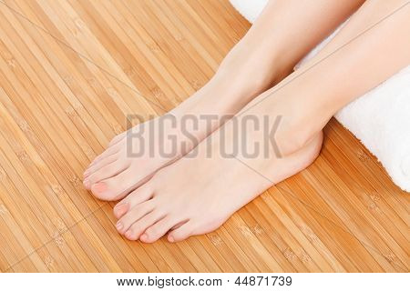 female feet with a white rolled towel