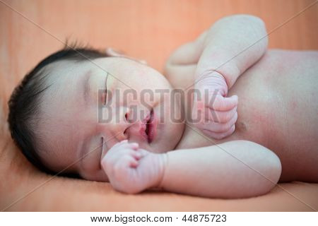 Newborn Asian baby girl sleeping, 7 days after birth