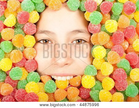 young girl buried on colored jellybeans