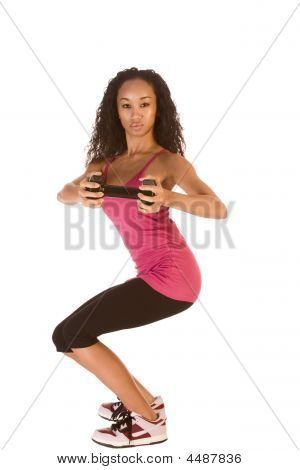 Slim Ethnic Woman Working Out With Black Dumbbell