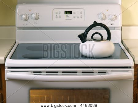 White Glass Stove With Tea Kettle