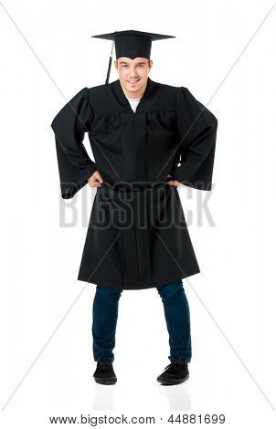 Cheerful graduate guy student in mantle, isolated on white background